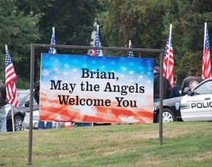 A message in front of St. Rose of Lima Church is addressed to Spc. Brian K. Arsenault.