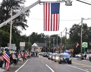 The funeral procession travels on Main Street.