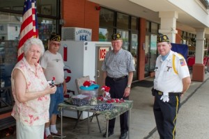 ( l to r) Bernice Conway, John Brewer,  Al Graefing and Larry Shafer outside Lowe's Market.  Conway's son, Kevin, is a veteran who has served in Iraq and Afghanistan.