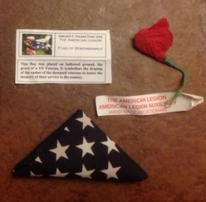 Small flags from the gravesites of veterans and the well-known poppy flowers were offered to shoppers going into Lowe's Market.