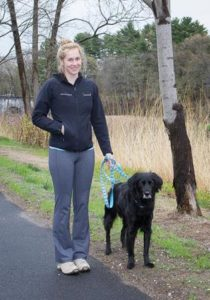Erin Girard and friend's dog Jimmy in front of the Wachusett Aqueduct in Northborough Photo/Jerry Callaghan