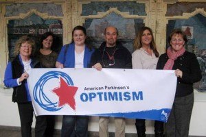 The MA Chapter APDA board members display the Optimism Walks
