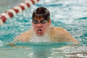 Algonquin's Ethan McRae rises for a breath as he swims the 100-yard breaststroke in a meet against Bromfield Jan. 6.