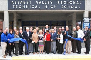State, local and school officials gather for a ribbon-cutting ceremony at the grand reopening of Assabet Valley Regional Technical High School.