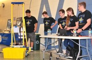 Aztechs 157 Robotics teammates conduct a demonstration.