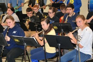 The AVRTHS Band members perform for guests.