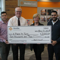 (l to r) Michael Petrillo, Framingham senior universal banker of Avidia Bank; Mark O'Connell, CEO & president of Avidia Bank; Joanne Barry, executive director of A Place to Turn; Fernando Ferreira, Framingham assistant branch manager of Avidia Bank.