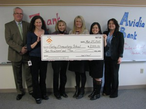 (l to r) Mark R. O'Connell, president and CEO, Avidia Bank; Lisette Zinner, Donalene Groom and Stacy McLeod, reading specialists at Farley Elementary School; Rachel Scanlon, Farley assistant principal; and Lisette Arbelli, Hudson South branch manager, Avidia Bank. (Photo/submitted)