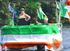 Riding on an Irish theme float are three generations: (l to r) Michael Fitzpatrick, 8, his mother Kelly, and her mother Joan.