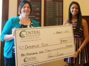 Algonquin Regional High School student Catherine Coad receives her $4,000 scholarship award.