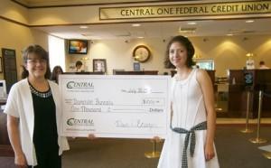 Domitille Buricatu of Shrewsbury High School receives her $1,000 scholarship.