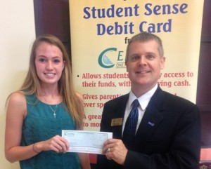 Shannon Connors of Westborough High School receives her $1,000 scholarship.