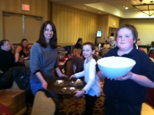Volunteers serve pies for dessert.