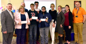 (l to r) Assabet Valley Regional Technical High School's Superintendent-Director, Ernie Houle;Deb Harper, lead instructor of design and visual communications; William May, design and visual teacher; students Gabe Morris, John Zouharis and Leo Zolli; Clinton Savings Bank's marketing team Ellen McGovern, Kristin Farraj and Christal Brown; and Assabet Valley's design and visual communications instructor Dennis Whitney. Photo/submitted.