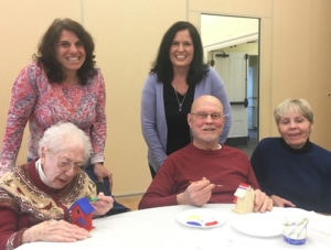 Gathered at the Hudson Senior Center during a DayBreak session are (back, l to r) Lisa Gardner, Hudson and lead program facilitator; Christine D'Angelo, Marlborough and Northborough program facilitator; and (front, l to r) DayBreak participants with a volunteer.