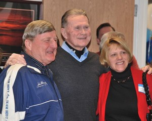 Pat Forrest (center) poses for a photo with Dick Hoyt and his girlfriend Kathy Boyer.