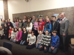 Worcester District Attorney Joseph D. Early Jr. with students from Northbridge Middle School