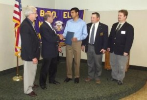 Anish Athalye of Shrewsbury receives the first-place scholarship from the Elks National Foundation in last year's Most Valuable Student Contest from (l to r) Mark Cronin, Auburn Webster Lodge, president-elect of the Massachusetts Elks Association, Frank Barone, Weymouth Lodge, past president (2012-2013), Paul Tibbets, past exalted ruler (2012-2013), and Don Geradi, exalted ruler of the Worcester Lodge of Elks. Photo/submitted