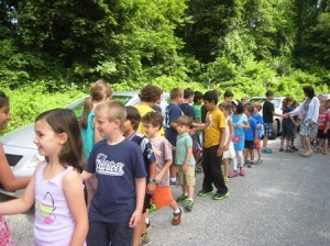 Shrewsbury - Spring Street School students and staff bid farewell to the fourth graders on the last day of school, June 19. The school's tradition is for fourth graders to line the circular driveway while the rest of the students and staff walk by and say goodbye to each fourth grade student.  Photo/Mary Pritchard