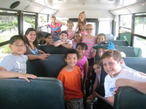 Some of the students in Floral Street School's Extended School Care Program in Shrewsbury board the bus for a last day of school field trip June 19.