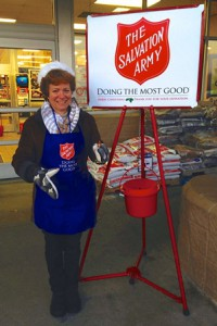 FFIT volunteer Deb Emery of Northborough rings the bell at the Price Chopper in Marlborough. Photo/submitted