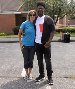 Fresh Air Fund volunteer and host, Julie North, stands with 17-year-old Malik on his ninth year visit.