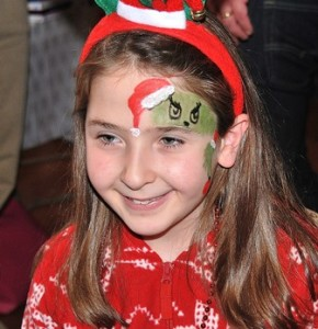 Annika Snell, 9, is pleased with the Grinch painted on her face.