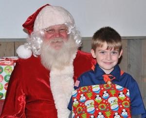 Jimmy J. Belanger, 6, gets a gift from Santa.