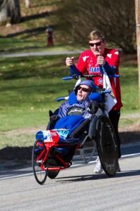 Dick Hoyt (running) pushes his son Rick near the start to the Boston Marathon.