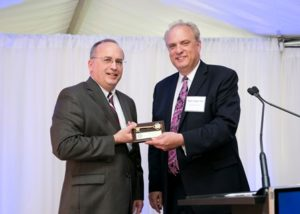 Mayor Joseph Petty presents David E. Surprenant and Mirick O'Connell with the key to the city of Worcester.