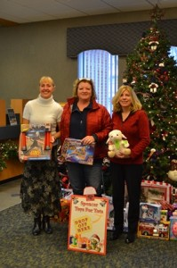 (l t r) Jennifer Anderson, SpencerBANK assistant vice president/mortgage officer, Donna Morin-Flannery, Spencer Toys for Kids coordinator and Lynne Esposito, SpencerBANK vice president/mortgage division manager, pose with donations recently made at the bank's main office drop-off location. Photo/submitted