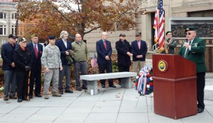 Denny Drewry, the quartermaster for the Westborough Veterans of Foreign Wars Post  9013, addresses the crowd at a ceremony held in front of the Forbes Municipal Building in Westborough Nov. 11.