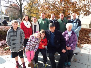 – Herbert Arnold, the grand marshal for Westborough's Veterans Day commemoration, poses for a photo with his wife Verne, and members of their family.
