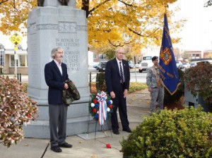 Westborough Town Moderator John Arnold (l) and retired Town Moderator Joseph Harrington reflect after placing the memorial wreath in front of the World War I memorial located at the town's rotary.