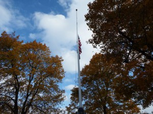 The flags at the town rotary are at hal-mast in honor of those veterans who have died.