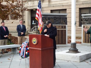 U.S. Navy veteran Herbert Arnold, the day's grand marshal,   addresses the crowd at a ceremony held in front of the Forbes Municipal Building in Westborough Nov. 11.