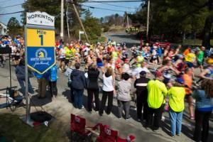 Boston Marathon runners pass the 1-mile mark in Hopkinton.