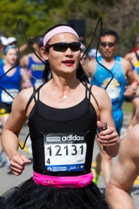 Rita Young of Palo Alto, Calif. runs with angel wings.