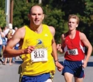 Chris Benestad (313) finishes first in the 2010 Applefest 5K Road Race in Northborough. (Photo/Ed Kavorski Jr.)
