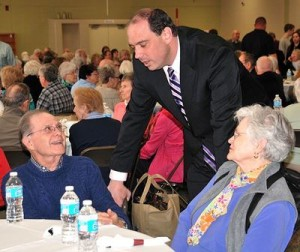 State Sen. Jamie Eldridge, D-Acton (center), meets Sy Sackler and Mary Allen, of Marlborough, during the luncheon at the 33rd annual Senior Conference held April 18. (Photo/Ed Karvoski Jr.)