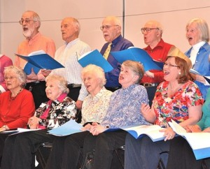 Members of the Southborough Senior Songsters, under the direction of Jim and Linda Duncan of Westborough, perform at the 34th annual Senior Conference, held April 24 at Hudson High School. Photo/Ed Karvoski Jr.