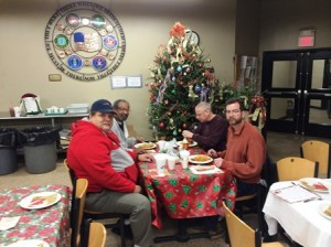 Four veterans enjoy a special breakfast at the Veterans Inc. shelter in Worcester. after receiving their gifts from Sweats for Vets.