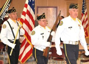 The American Legion Vincent F. Picard Post 234 Color Guard leads the Vietnam veterans.