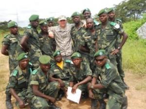 Dan Koleda poses with soldiers at Mura base camp. Photo/Dan Kolenda