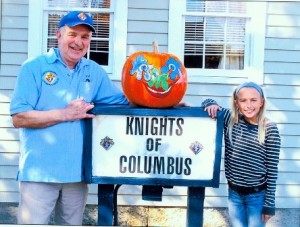 Contest winner Brooke Gaddie is congratulated by Knights of Columbus member Val Provencher (left). (Photo/submitted)