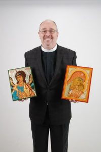 St. Mark's Episcopal Church's new deacon, The Venerable Michael Hamilton, holds icons he painted.     (Photo/Christine Galeone)