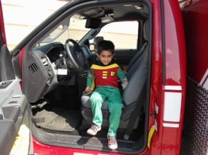 Radeen, age 5, sits in the driver's seat of a Southborough ambulance as part of Heroes Week at the Southborough Recreation Department's summer camp.