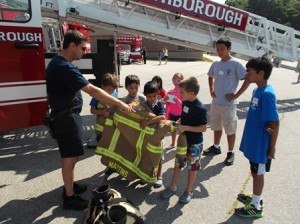 Campers at Finn School learn about the gear that every firefighter wears while on the job.