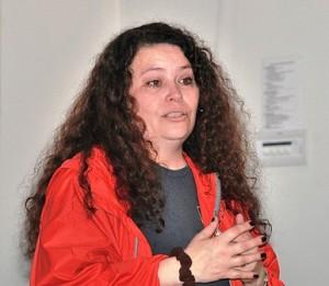 Lisa Braccio welcomes volunteers to the opening ceremony.