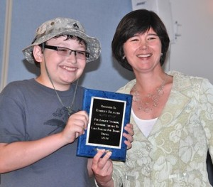 Robert Braccio, 12, is recognized as the longest-running volunteer for the drive by state Rep. Carolyn Dykema.